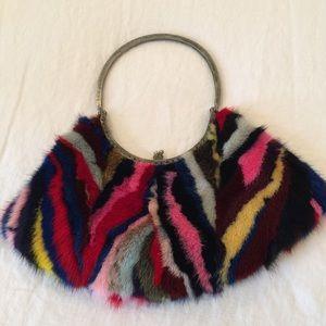 Clara Kasavina  multi color fur clutch